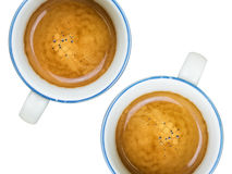 Two cups of coffee. Multiple coffee with cream in blue cups on white background Stock Photo