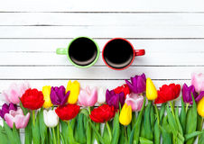 Two cups of coffee near tulips Royalty Free Stock Photo