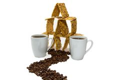 Two cups of coffee next to the cookie house, the road from the coarse grains royalty free stock images
