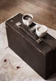Two cups of coffee and old suitcase Stock Photos
