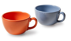 Two cups of coffee, orange and blue on a white background Royalty Free Stock Image