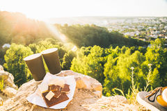 Two cups of coffee on the peak of the hill Royalty Free Stock Photography