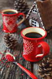 Two cups of coffee and  pine cones Stock Images