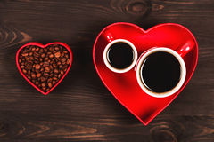 Two cups of coffee in the red heart Royalty Free Stock Photography