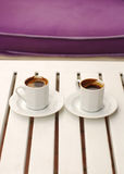 Two cups of coffee. Coffee cups and saucers on a white table Stock Photo