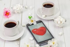 Congratulations to Valentine`s Day on the smartphone screen stock photo