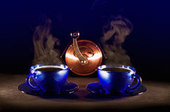 Two cups of coffee soaring. On black background Royalty Free Stock Photography