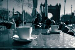 Coffee at the Arch of Triumph, Barcelona. Two cups of coffee on a street bar at the Arch of Triumph, Barcelona Royalty Free Stock Image