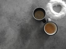 Two cups of coffee with sugar heart, the perfect breakfast lovers. royalty free stock images