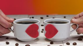 Two cups of coffee for sweethearts. Romance in Valentine`s Day. Two cups coffee for sweethearts, romance in valentine day, black hot coffee in white cups stock footage