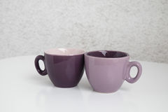 Two cups for coffee. Two coffee cups an a table Royalty Free Stock Photos