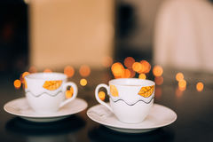 Two cups of coffee on table on background bokeh. Stock Photo