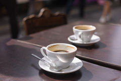 Two cups of coffee on table outside Royalty Free Stock Image