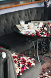 Two cups of coffee on a table strewn with petals. The guy just confessed his love to his girlfriend Stock Photo