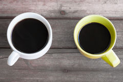 Two cups of coffee on table Stock Images