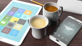 Two cups with coffee, tablet, smartphone,notepad and pencil Stock Image