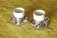 Two cups of coffee in two materials_2 Stock Photography