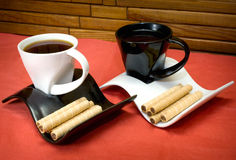 Two cups of coffee and wafer sticks with chocolate Stock Photo
