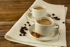 Two cups of coffee on the white napkin, copy space Stock Images