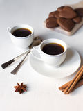 Two cups of coffee on white table and with two spoons and ch Stock Photo