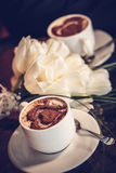 Two cups of coffee and white tulips. Close up royalty free stock photo