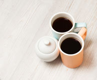 Two cups of coffee on white wooden table. Top view, flat lay. Two cups of coffee on white wooden table. Top view, flat lay Stock Photography