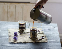 Two cups of coffee on the wooden background Royalty Free Stock Photography