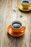 Two Cups. Of coffee on a wooden table Stock Image