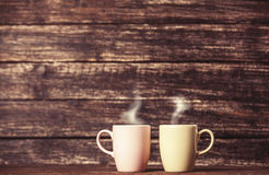 Two cups of coffee. On wooden table Stock Photo
