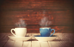 Two cups of coffee on wooden table Stock Photos