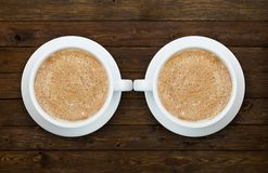 Two cups of coffee on the wooden table Stock Photos