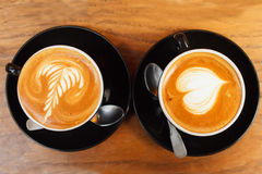 Two cups of coffee on a wooden table, top view Royalty Free Stock Photography