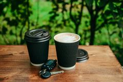 Two cups of coffee on the wooden table Stock Images