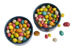Two cups with colored candy Royalty Free Stock Photos