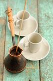 Two cups and copper cezve with fresh black coffee on old wooden Royalty Free Stock Photography