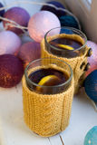 Two cups of delicious tea in knitted sweater Stock Image