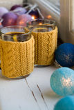 Two cups of delicious tea in knitted sweater Royalty Free Stock Photos