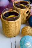 Two cups of delicious tea in yellow  sweater Royalty Free Stock Photos