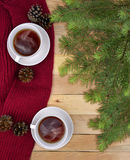 Two cups of drink, and Christmas tree branches. Christmas. Commu Stock Photos