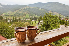 Two cups of drink. Mountain view Royalty Free Stock Photo