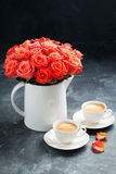 Two cups of espresso and a bouquet of roses. Selective focus Stock Photos