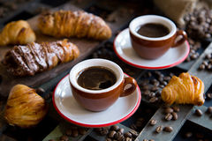 Two cups of espresso with Italian traditional baking Stock Images