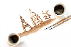 Two cups of espresso with painting brushes and hand drawing attractions of Paris, France. Coffee art or creative concept. Top view stock illustration