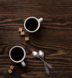Two cups of espresso with pieces of cane sugar. Stock Images