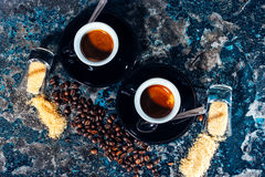 Two cups of espresso with sugar and coffee beans Stock Photos