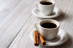 Two cups of espresso on a white wooden table.  Stock Images