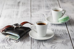 Two cups of espresso on a white wooden table. Two cups of espresso on a white wooden table Royalty Free Stock Photography