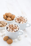 Two cups of flavored cocoa with marshmallow and cookies Royalty Free Stock Photography
