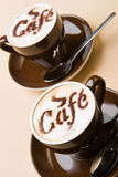 Two cups of fresh cappuccino Stock Images