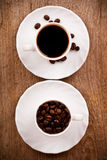 Two cups full of coffee Royalty Free Stock Photos